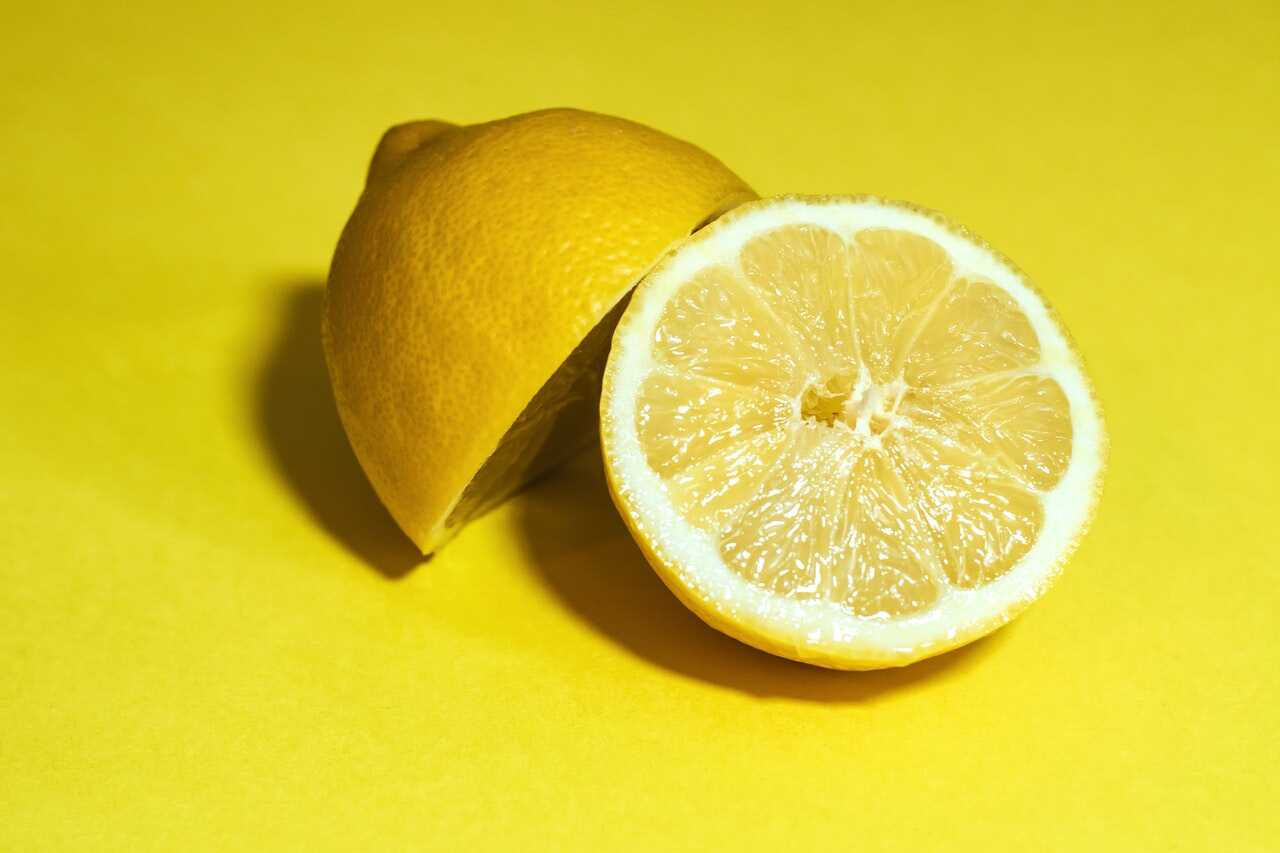 sliced lemon over a yellow background